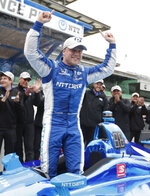 Felix Rosenqvist, of Sweden, celebrates after winning the pole during qualifications for the Indy GP IndyCar auto race at Indianapolis Motor Speedway, Friday, May 10, 2019 in Indianapolis. (AP Photo/Michael Conroy)