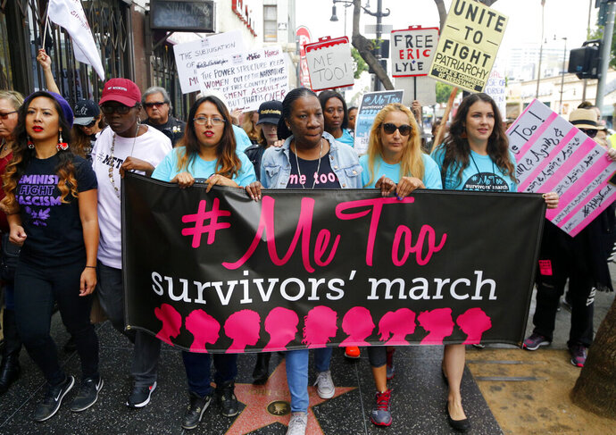 FILE - In this Nov. 12, 2017 file photo, participants march against sexual assault and harassment at the #MeToo March in the Hollywood section of Los Angeles. The number of complaints against California physicians for sexual misconduct has risen 62% since fall of 2017, a jump that coincides with the beginning of the #MeToo movement, according to a newspaper investigation published Monday, Aug. 12, 2019. A Los Angeles Times analysis of California medical board data found complaints of sexual misconduct, though small in number, are among the fastest growing type of allegation. (AP Photo/Damian Dovarganes, File)