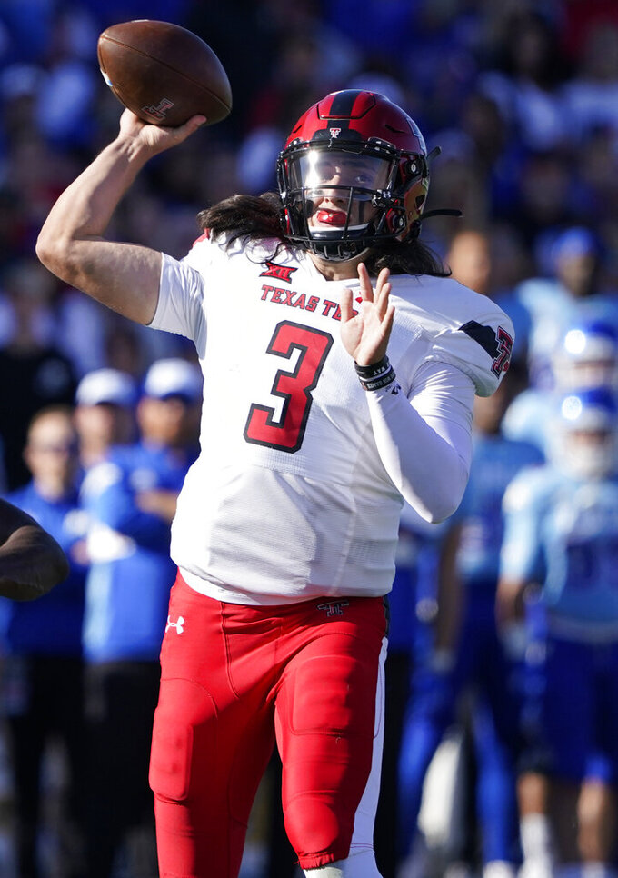 Texas Tech quarterback Henry Colombi (3) looks to pass against Kansas during the first quarter of an NCAA college football game Saturday, Oct. 16, 2021, in Lawrence, Kan. (AP Photo/Ed Zurga)