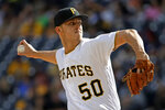 Pittsburgh Pirates starting pitcher Jameson Taillon delivers during the first inning of a baseball game against the San Francisco Giants in Pittsburgh, Saturday, April 20, 2019. (AP Photo/Gene J. Puskar)