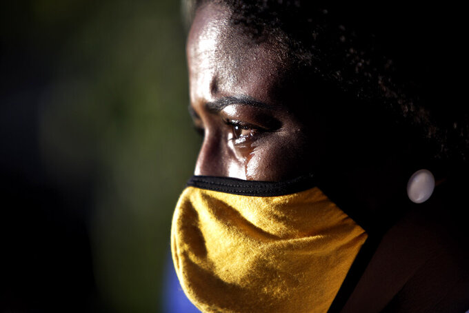 A family member cries during the funeral of Kathlen Romeu, a young pregnant woman killed by a stray bullet, in Rio de Janeiro, Brazil, Wednesday, June 9, 2021. Stray bullets have struck at least six pregnant women in Rio since 2017, but Romeu was the first to die, according to Crossfire, a non-governmental data project that tracks armed violence. (AP Photo/Bruna Prado)