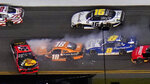 Ty Dillon (54) goes sideways in front of Daniel Hemric (18), and Josh Berry (8) during a multi-car crash during a NASCAR Xfinity Series auto race Saturday, Feb. 13, 2021, at the Daytona International Speedway in Daytona Beach, Fla. (AP Photo/Chris O'Meara)