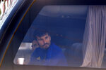 Argentina's Boca Juniors soccer team goalkeeper Javier Garcia peers out the window of his team's bus parked outside a police station in Belo Horizonte, Brazil, Wednesday, July 21, 2021, the morning after the team was eliminated from the Copa Libertadores tournament which ended in a brawl and destruction in the locker room. (AP Photo/Bruna Prado)
