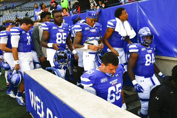 Georgia State players leaves the field after an NCAA football game agaionst Coastal Carolina, Saturday, Oct. 31, 2020, in Atlanta. Coastal Carolina won 51-0. (AP Photo/John Amis)