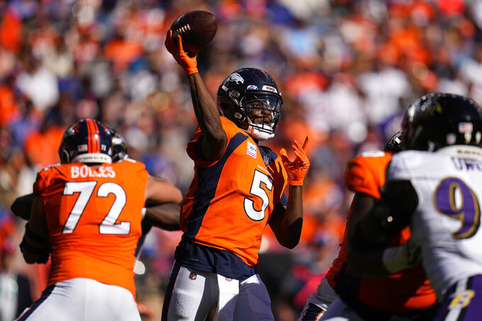 Denver Broncos quarterback Teddy Bridgewater (5) throws against the Baltimore Ravens during the first half of an NFL football game, Sunday, Oct. 3, 2021, in Denver. (AP Photo/Jack Dempsey)