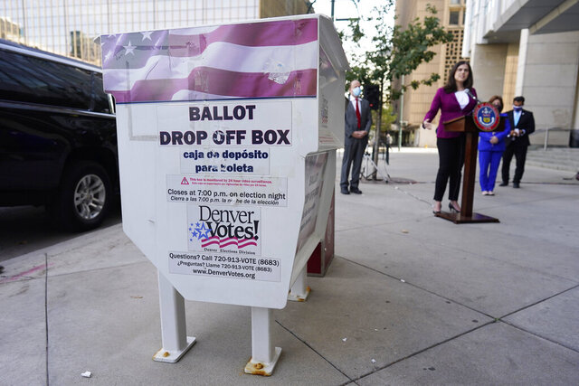 Colorado Secretary of State Jena Griswold speaks during a news conference about the the state's efforts to protect the process of casting a vote in the upcoming general election Thursday, Oct. 15, 2020, in downtown Denver. (AP Photo/David Zalubowski)