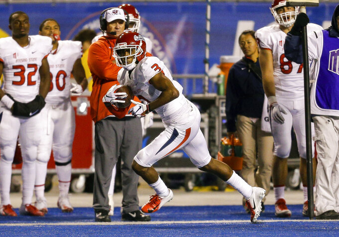 Fresno State wide receiver KeeSean Johnson (3) turns up field after a reception against Boise State in the second half of an NCAA college football game, Friday, Nov. 9, 2018, in Boise, Idaho. Boise State won 24-17 over Fresno State. (AP Photo/Steve Conner)