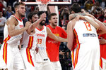 Members of Spain's team celebrate after winning their semifinal match against Australia in double overtime in the FIBA Basketball World Cup at the Cadillac Arena in Beijing, Friday, Sept. 13, 2019. (AP Photo/Mark Schiefelbein)