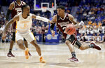 Mississippi State guard Lamar Peters (2) drives against Tennessee guard Jordan Bone (0) in the first half of an NCAA college basketball game at the Southeastern Conference tournament Friday, March 15, 2019, in Nashville, Tenn. (AP Photo/Mark Humphrey)