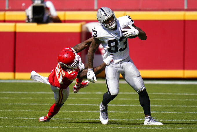Las Vegas Raiders tight end Darren Waller (83) tries to break a tackle by Kansas City Chiefs cornerback Bashaud Breeland, left, during the first half of an NFL football game, Sunday, Oct. 11, 2020, in Kansas City. (AP Photo/Jeff Roberson)