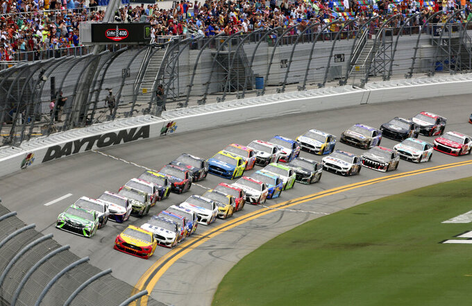 Kyle Busch, front left, and Joey Logano, front right, lead the field to start the NASCAR Cup Series auto race at Daytona International Speedway, Sunday, July 7, 2019, in Daytona Beach, Fla. (AP Photo/David Graham)