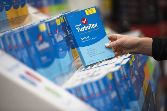 FILE - In this April 18, 2016 file photo a person looks at Intuit TurboTax software on display at a retailer in Foster City, Calif. Intuit announced Monday, Feb. 24, 2020, that it is buying consumer finance company Credit Karma in a $7.1 billion cash and stock deal. (Peter Barreras/AP Images for Turbo Tax Via AP, File)