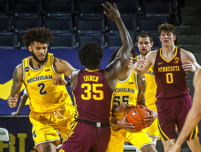 Minnesota forward Isaiah Ihnen (35) collides with Michigan guard Eli Brooks (55) in the second half of an NCAA college basketball game at Crisler Center in Ann Arbor, Mich., Wednesday, Jan. 6, 2021. Brooks lost a tooth from the impact and left the game. (AP Photo/Tony Ding)