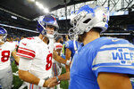 New York Giants quarterback Daniel Jones (8) and Detroit Lions quarterback Matthew Stafford meet after an NFL football game, Sunday, Oct. 27, 2019, in Detroit. (AP Photo/Paul Sancya)