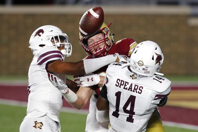 Texas State safeth Zion Childress, left, and safety Tory Spears (14) break up a pass intended for Boston College tight end Hunter Long during the first half of an NCAA college football game Saturday, Sept. 26, 2020, in Boston. (AP Photo/Michael Dwyer)