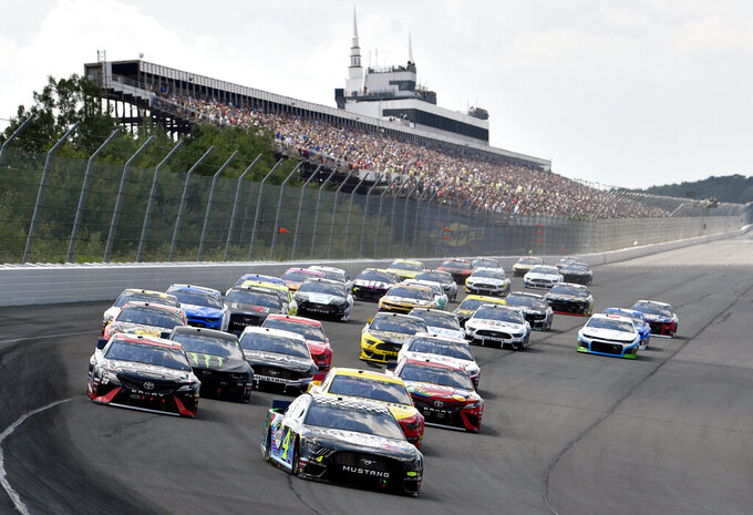 Kevin Harvick leads the field into Turn 1 to start a NASCAR Cup Series auto race, Sunday, July 28, 2019, in Long Pond, Pa. (AP Photo/Derik Hamilton)