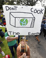 A young activist holds up a handmade placard as thousands of protestors, many of them school students, gather in Sydney, Friday, Sept. 20, 2019, calling for action to guard against climate change. Australia's acting Prime Minister Michael McCormack has described ongoing climate rallies as