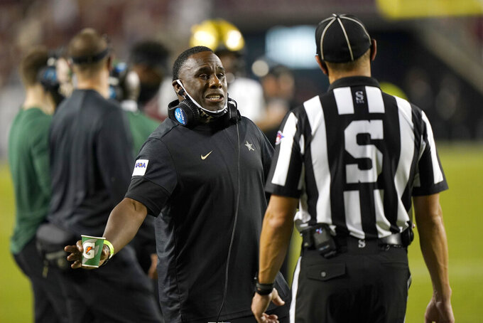 Vanderbilt coach Derek Mason talks to an official during the second half of an NCAA college football game against Texas A&M Saturday, Sept. 26, 2020, in College Station, Texas. Texas A&M won 17-12. (AP Photo/David J. Phillip)