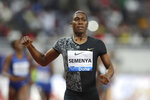 FILE - In this May 3, 2019, file photo, South Africa's Caster Semenya crosses the line to win the gold in the women's 800-meter final during the Diamond League in Doha, Qatar. Olympic champion Caster Semenya has run her first public race in eight months and says she will be back in top-level track despite currently being banned from competing in her favorite event. (AP Photo/Kamran Jebreili, File)
