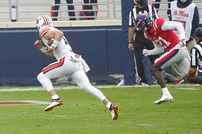Auburn quarterback Bo Nix (10) runs past Mississippi defensive back A.J. Finley (21) for a touchdown during the first half of an NCAA college football game in Oxford, Miss., Saturday Oct. 24, 2020. (AP Photo/Rogelio V. Solis)