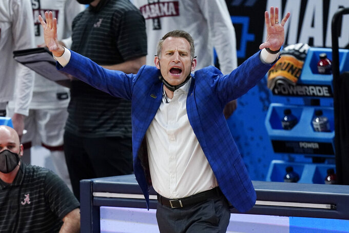 FILE - In this March 22, 2021, file photo, Alabama head coach Nate Oats directs his players during the second half against Maryland in the second round of the NCAA college basketball tournament at Bankers Life Fieldhouse in Indianapolis. (AP Photo/Mark Humphrey, File)