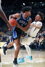Duke center Vernon Carey Jr. (1) fouls Georgia Tech forward James Banks III (1) in the second half of an NCAA college basketball game Wednesday, Jan. 8, 2020, in Atlanta. Duke won 73-64. (AP Photo/John Bazemore)