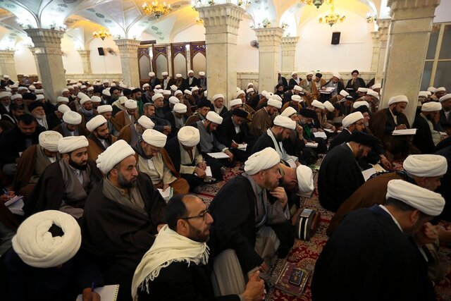 In this Sunday, Feb. 2, 2020, Shiite seminary students attend a lecture at