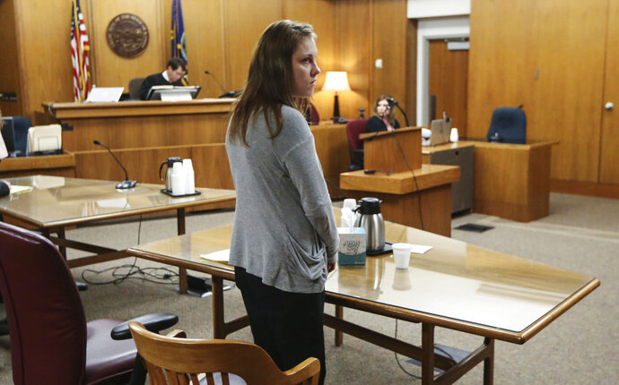 Emily Glass appears in Sedgwick County District Court in Wichita, Kan., Wednesday, May 16, 2018. Glass, the stepmother of a 5-year-old Wichita boy who has been missing since February, was found not guilty Wednesday of child endangerment in an unrelated case involving her own daughter. (Travis Heying/The Wichita Eagle via AP)