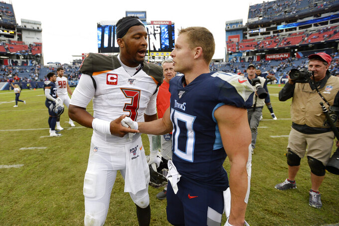 Tampa Bay Buccaneers quarterback Jameis Winston (3) shakes hands with Tennessee Titans wide receiver Adam Humphries (10) after an NFL football game Sunday, Oct. 27, 2019, in Nashville, Tenn. The Titans won 27-23. (AP Photo/Mark Zaleski)