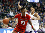 Texas Tech guard Jarrett Culver (23) gets through the defense of TCU's Alex Robinson, center rear, and Desmond Bane, right rear, in the first half of an NCAA college basketball game in Fort Worth, Texas, Saturday, March 2, 2019. (AP Photo/Tony Gutierrez)