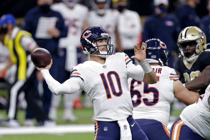 Chicago Bears quarterback Mitchell Trubisky (10) passes in the first half of an NFL wild-card playoff football game against the New Orleans Saints in New Orleans, Sunday, Jan. 10, 2021. (AP Photo/Brett Duke)