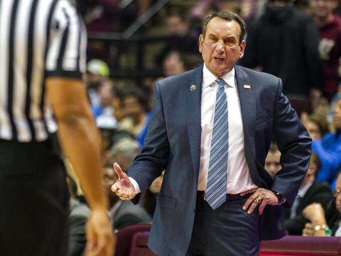 FILE - In this Jan. 12, 2019, file photo, Duke head coach Mike Krzyzewski talks with a referee in the second half of an NCAA college basketball game against Florida State in Tallahassee, Fla. This season's college basketball schedule at Madison Square Garden tips off next month with a marquee doubleheader featuring four powerhouse programs: Duke, Kansas, Kentucky and Michigan State. (AP Photo/Mark Wallheiser, File)