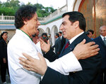 FILE - In this Aug.2, 2000 file photo, Libyan leader Col. Moammar Gadhafi, left, is welcomed by Tunisian President Zine El Abidine Ben Ali in Tunis. Tunisia's autocratic ruler Zine El Abidine Ben Ali, toppled in 2011, died in exile in Saudi Arabia. (AP Photo, File)