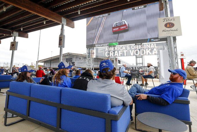 Fans watch qualifying as they explore the new facilities and garages at Talladega Superspeedway, Saturday, Oct. 12, 2019, in Talladega, Ala. (AP Photo/Butch Dill)