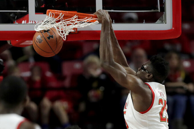 Maryland forward Jalen Smith dunks on Rhode Island during the second half of an NCAA college basketball game, Saturday, Nov. 9, 2019, in College Park, Md. (AP Photo/Julio Cortez)