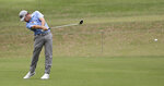 South Africa's Louis Oosthuizen plays his second shot on the 5th hole during the second round of the Australian Open golf tournament in Sydney, Friday, Dec. 6, 2019. (AP Photo/Rick Rycroft)