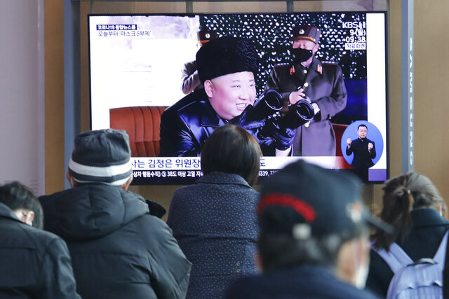 People watch a TV showing a file image of North Korean leader Kim Jong Un during a news program at the Seoul Railway Station in Seoul, South Korea, Monday, March 9, 2020. North Korea fired three unidentified projectiles off its east coast on Monday, South Korea's military said, two days after the North threatened to take