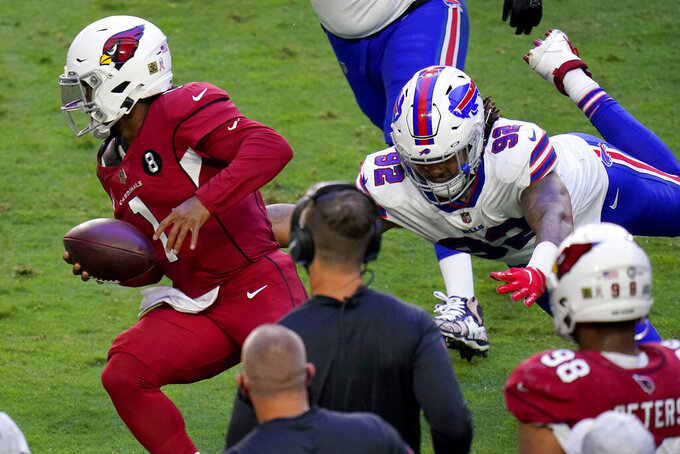Arizona Cardinals quarterback Kyler Murray (1) escapes the reach of Buffalo Bills defensive end Darryl Johnson (92) during the first half of an NFL football game, Sunday, Nov. 15, 2020, in Glendale, Ariz. (AP Photo/Ross D. Franklin)