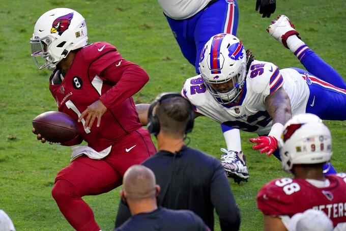 Arizona Cardinals quarterback Kyler Murray (1) escapes the reach of Buffalo Bills defensive end Darryl Johnson (92) during the first half of an NFL football game, Sunday, Nov. 15, 2020, in Glendale, Ariz. (AP Photo/Ross D. Franklin)