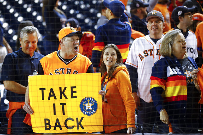 Houston Astros fans cheer after Game 5 of the baseball World Series Washington Nationals Sunday, Oct. 27, 2019, in Washington. The Astros won 7-1 to take a 3-2 lead in the series. (AP Photo/Patrick Semansky)