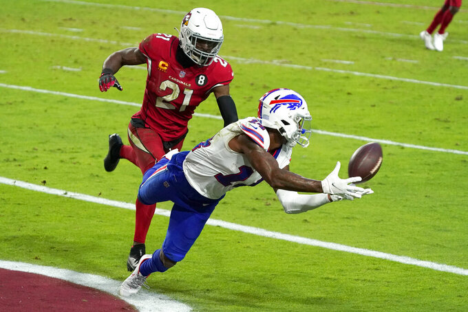 Buffalo Bills wide receiver Stefon Diggs (14) pulls in a touchdown pass as Arizona Cardinals cornerback Patrick Peterson (21) defends during the second half of an NFL football game, Sunday, Nov. 15, 2020, in Glendale, Ariz. (AP Photo/Rick Scuteri)