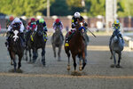 Jockey John Velazquez riding Authentic, second right, leads the field to win the 146th running of the Kentucky Derby at Churchill Downs, Saturday, Sept. 5, 2020, in Louisville, Ky. (AP Photo/Mark Humphrey)
