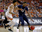 Xavier forward Naji Marshall (13) drives against Texas forward Gerald Liddell (0) during an NCAA college basketball game in the second round of the NIT on Sunday, March 24, 2019, in Austin, Texas. (Nick Wagner/Austin American-Statesman via AP)