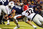 Auburn quarterback Bo Nix (10) carries the ball in for a touchdown as he gets past Georgia linebacker Monty Rice (32) during the second half of an NCAA college football game, Saturday, Nov. 16, 2019, in Auburn, Ala. (AP Photo/Butch Dill)