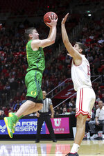 Oregon guard Payton Pritchard (3) shoots over Utah forward Novak Topalovic (13) during the first half of an NCAA college basketball game Thursday, Jan. 31, 2019, in Salt Lake City. (AP Photo/Chris Nicoll)