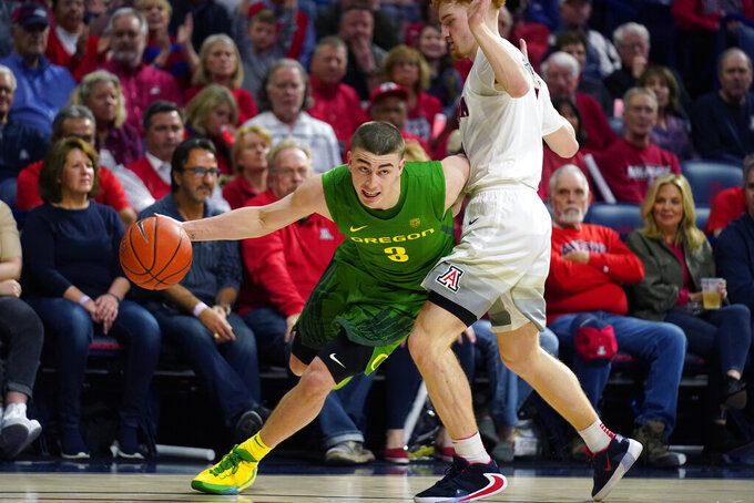 FILE - In this Feb. 22, 2020, file photo, Oregon guard Payton Pritchard (3) drives against Arizona during the first half of an NCAA college basketball game in Tucson, Ariz. Pritchard was selected to The Associated Press All-America first team, Friday, March 20, 2020. (AP Photo/Rick Scuteri, Fle)