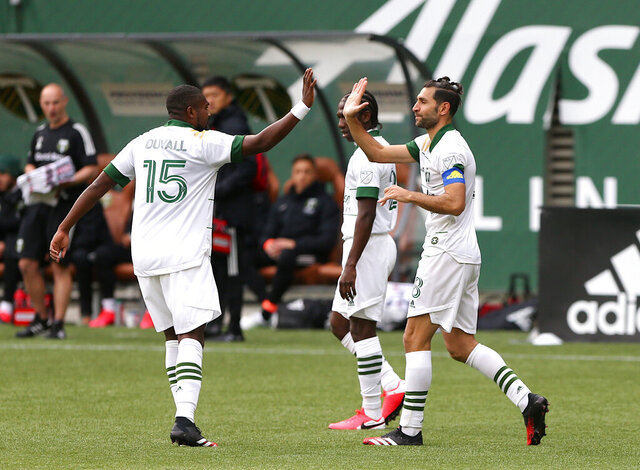 Portland Timbers' Diego Valeri, right, celebrates his goal with his teammate in an MLS soccer match against Nashville SC in Portland, Ore., Sunday, March 8, 2020. (Sean Meagher/The Oregonian via AP)