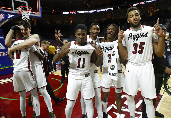 New Mexico State players celebrate after an 89-57 win over Grand Canyon in an NCAA college basketball game for the Western Athletic Conference men's tournament championship Saturday, March 16, 2019, in Las Vegas. From left are Jabari Rice (10), Ivan Aurrecoechea, Keyon Jones (11), Berrick JeanLouis, Terrell Brown (3) and Johnny McCants. (AP Photo/Steve Marcus)