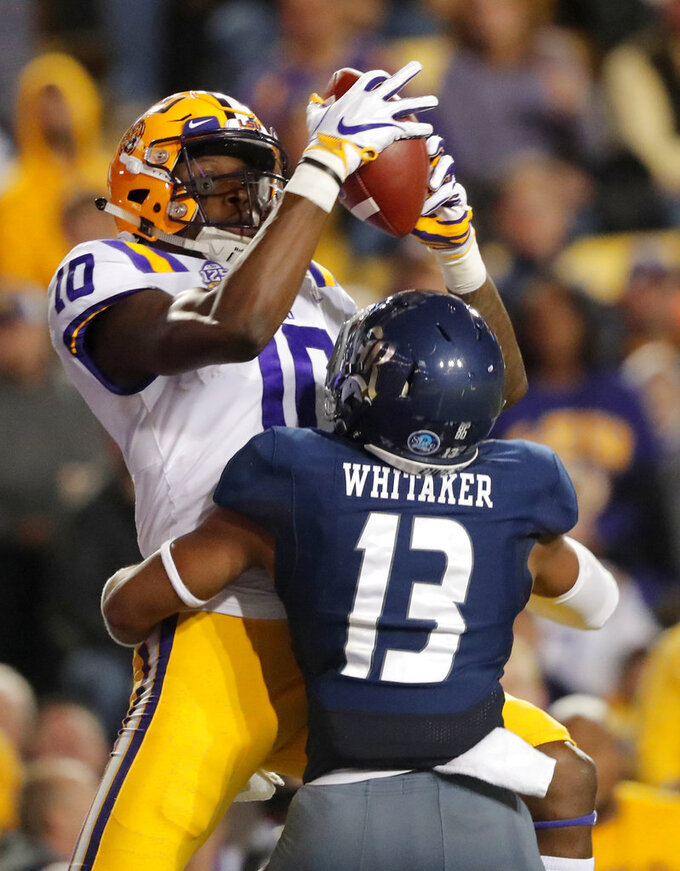 LSU wide receiver Stephen Sullivan (10) pulls in a touchdown reception over Rice cornerback Collin Whitaker (13) in the first half of an NCAA college football game in Baton Rouge, La., Saturday, Nov. 17, 2018. (AP Photo/Gerald Herbert)