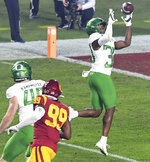 Wide receiver Jaylon Redd of Oregon catches a pass and runs for a touchdown against USC in the first half of an NCAA college football game at the Los Angeles Memorial Coliseum in Los Angeles on Friday, Dec. 18, 2020. (Keith Birmingham/The Orange County Register via AP)